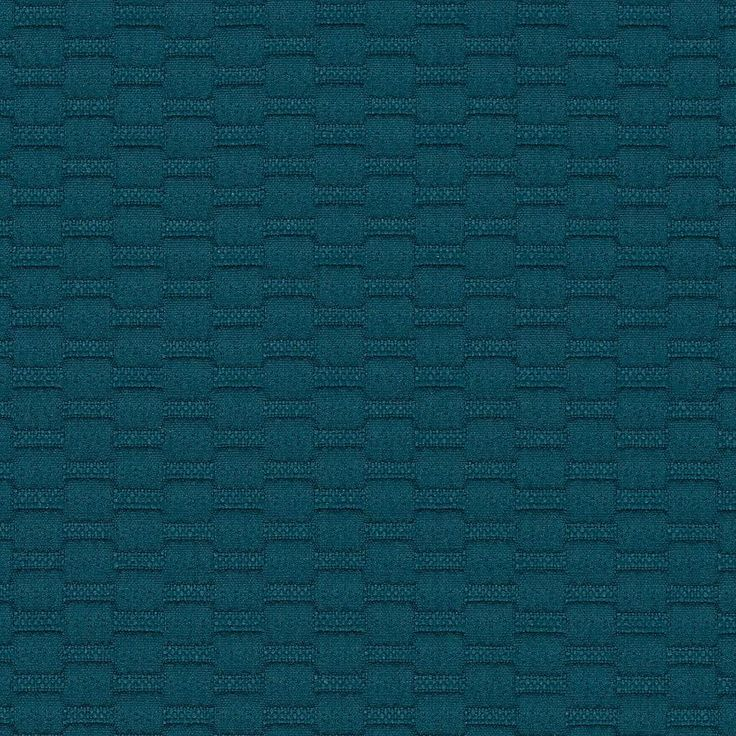 Implex - Fathom | Implex is a modern take on a classic matelassé with a textural appearance created by a shrink yarn. This piece-dyed fabric has a basket weave appearance with subtle vertical and horizontal banding, providing a rhythm of high and low areas. These give the fabric an exaggerated all-over texture that provides its visual and tactile appeal. The color palette offers a range of deep saturated tones along with neutrals found in building materials such as concrete, stone and metal.