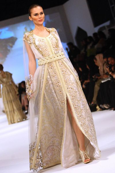 A model presents a creation by Moroccan designer Zhor Rais during the 2013 Muscat Fashion Week in the Omani capital