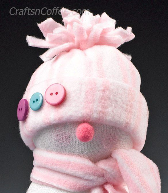 What a sweet face on this easy Sock Snowman. DIY on CraftsnCoffee.com.