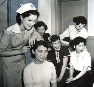 Japanese war brides arriving in America receive instructions on the latest fashionable hairstyles.