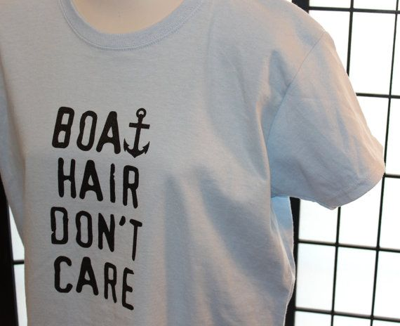 Boat Hair Dont Care T-Shirt. Light Blue Gildan Cotton T-shirt for Women. Design has been screen printed on in black ink & cured at a high temp to insure it will not wash out. Matching anchor design printed on back in between shoulder area.