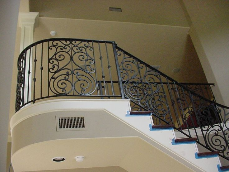 Amazing Black Wrought Iron Stair Railing With Solid Brown Wood .