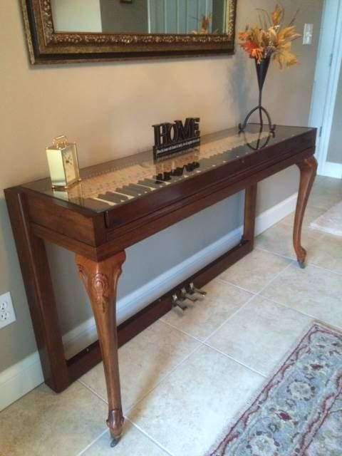 Wurlitzer repurposed piano with beautiful legs I turned into a hall table.