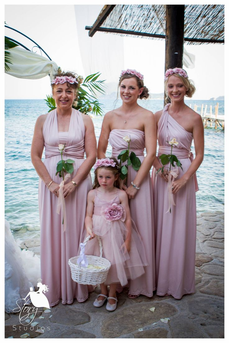 Beautiful bridesmaids and flower girl! Dressed in pastel pink dresses and bohemian floral hair accessories!