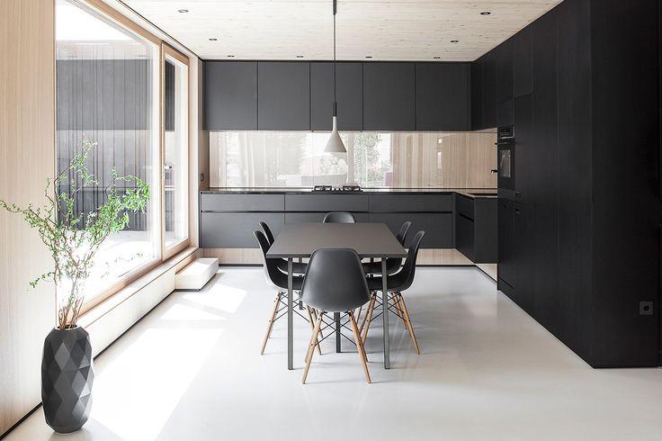 Soaring ceilings, built-in furniture, and minimal color make this German home feel huge.