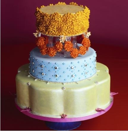 Monsoon Wedding Cake - Indian Wedding Inspiration: Orange and Gold Marigold Garlands, Multi-hued Patterns Saris, and Festive Shiny Jewels.  Cake By Kate Sullivan.