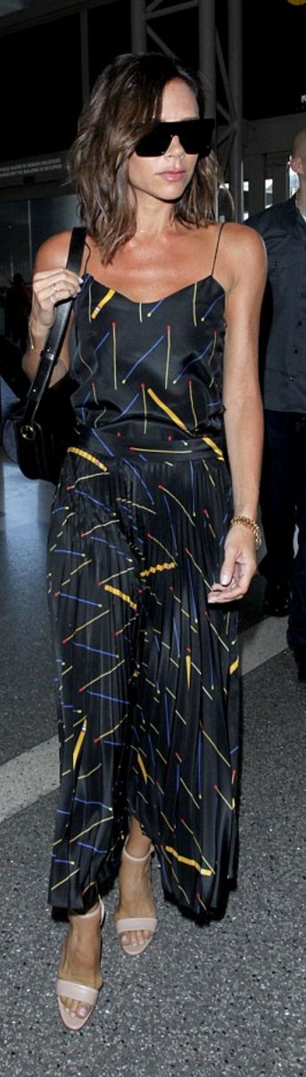 Who made  Victoria Beckham's black sunglasses, pleated print skirt, spaghetti tank top, and handbag?