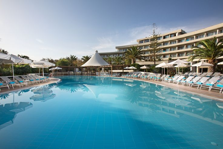 Relax by the pool at Agapi Beach Hotel