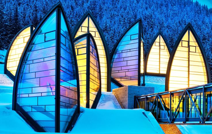 """Tschuggen Berg Oase"": The spa at Tschuggen Grand Hotel features glass ""leaves"" that pop up through the snow covered roofs; Arosa, Switzerland 