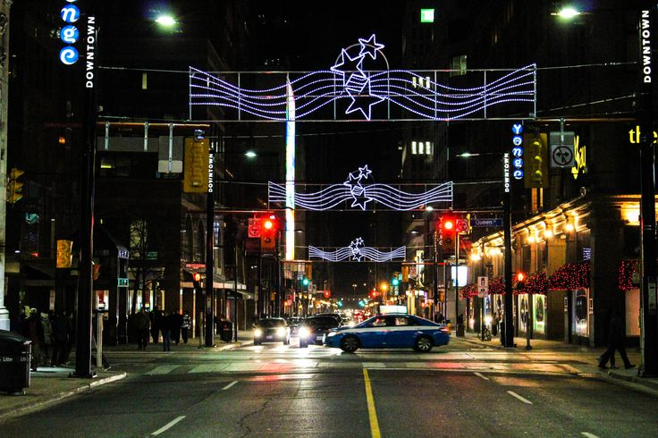 Christmas In Toronto - Travel photo of the day - The street lights in Toronto Canada welcome the holiday season. Toronto's downtown core is always buzzling with activity.  #ChristmasInToronto  http://www.farawayvacationrentals.com/view-blog/Christmas-In-Toronto/381