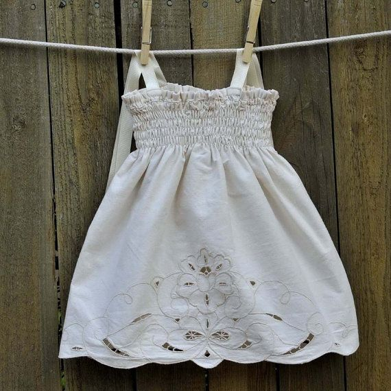 i think i've got some old curtains or table cloths with detail like this--never thought of doing the faux-smocked top