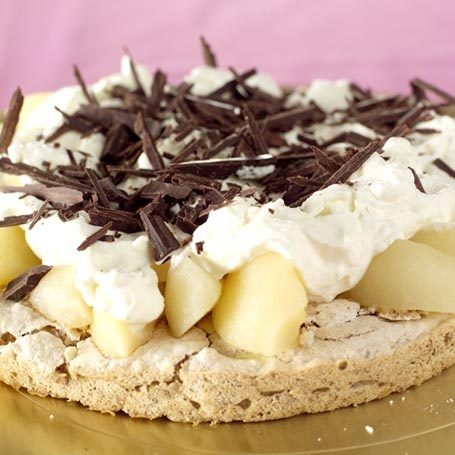 Typical modern style Norwegian cake - almond nut cake with pears, whipped cream and grated chocolate.