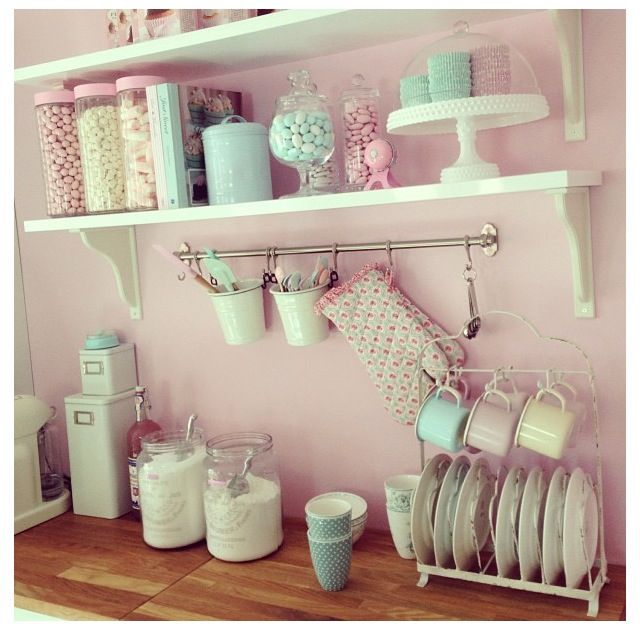 The open shelves create a delicate and fresh look; the delicate look is enmeshed by the soft color palette.