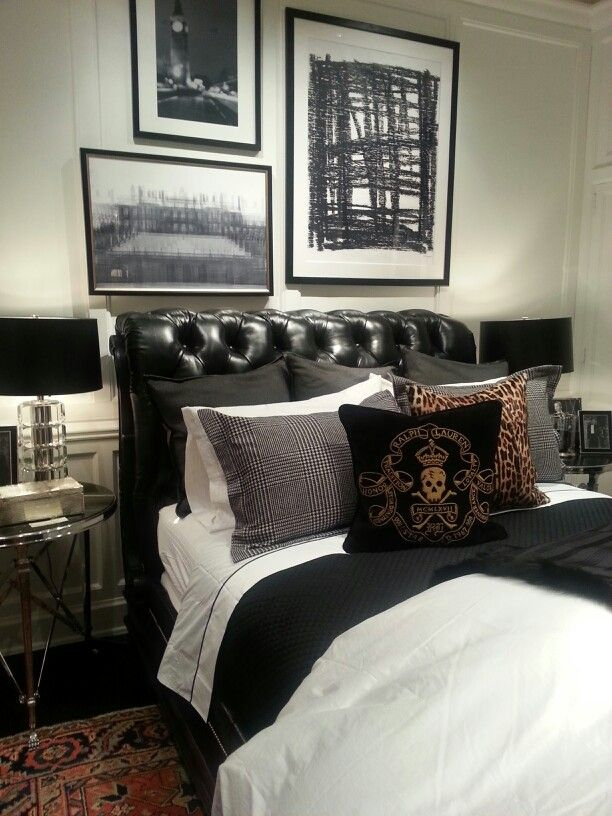 The epitome of masculine bedroom styling - Those black and white framed photography pictures complete the set perfectly - Ralph Lauren