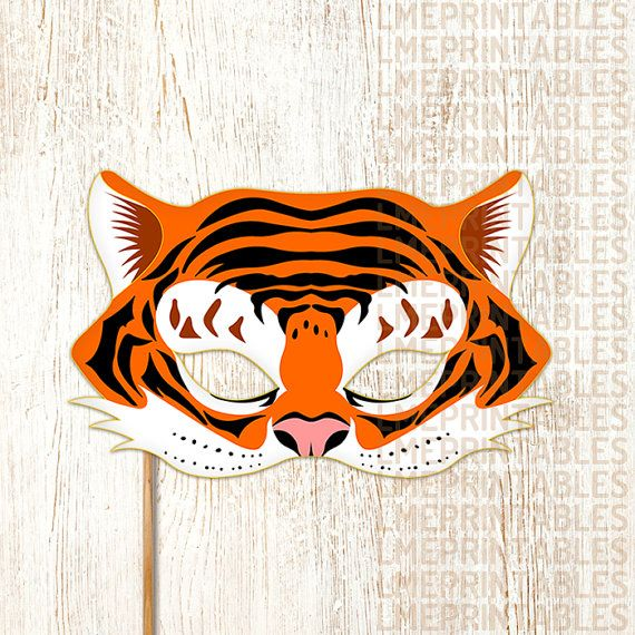 Tiger Mask PDF File Ready to Print Cut and Enjoy! This item Include: • PDF files ready for printing and instructions for making the mask. • JPG files ready for printing and instructions for making the mask. Features: • Large eye holes for wearing comfort. • Paper Format A4: 21 x 29,7