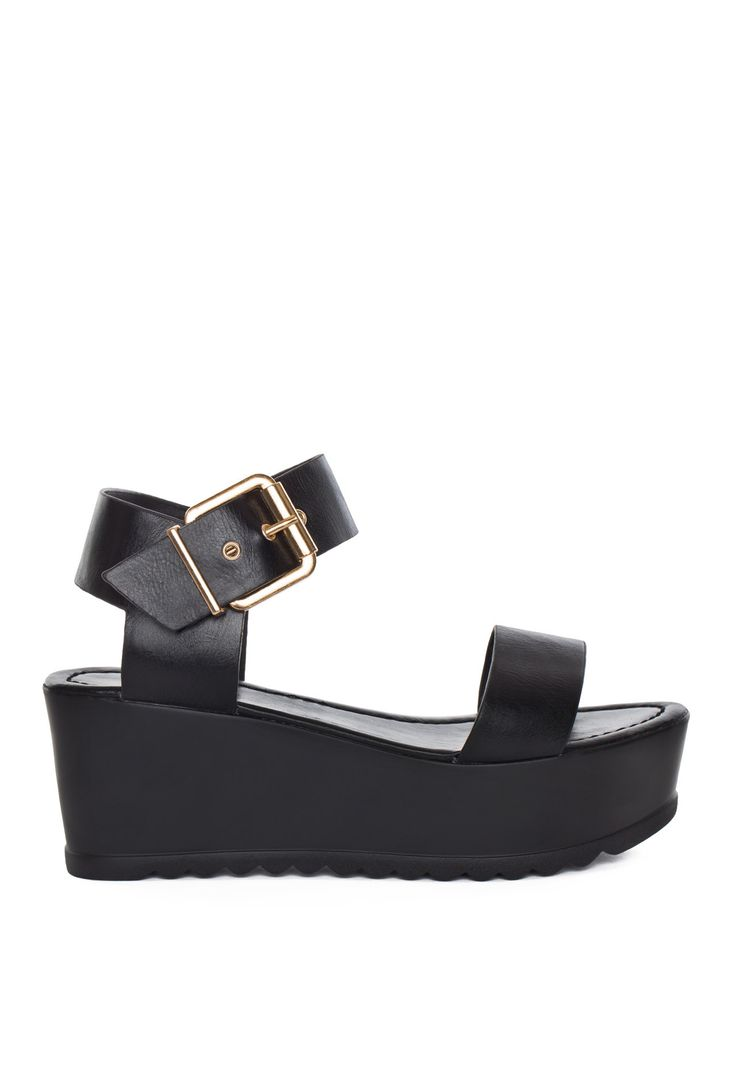 Yo tell me what you want, what you really, really want! Our Posh Spice Platform Sandals feature a black pleather material with a platform base, slightly raised at the heel. Single toe strap, open heel