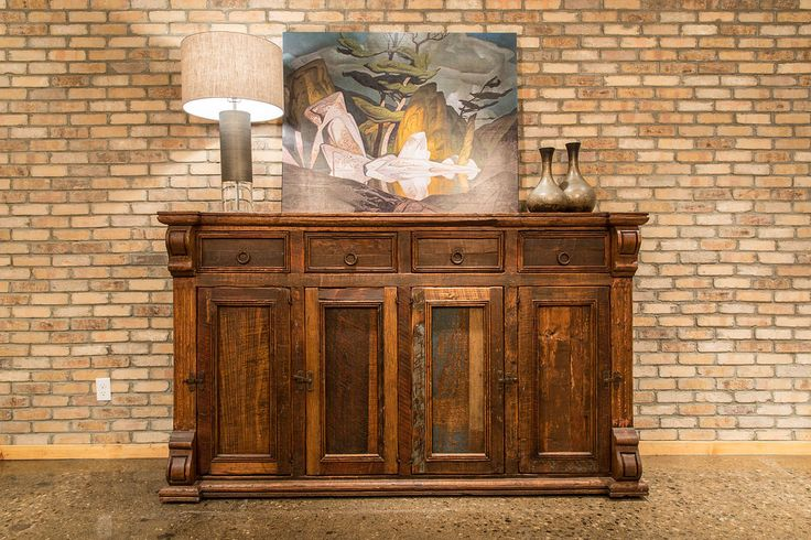 Fine details enhance the beauty of this salvaged wood buffet. Handmade by craftsmen that have continued to use old construction methods passed on through generations.