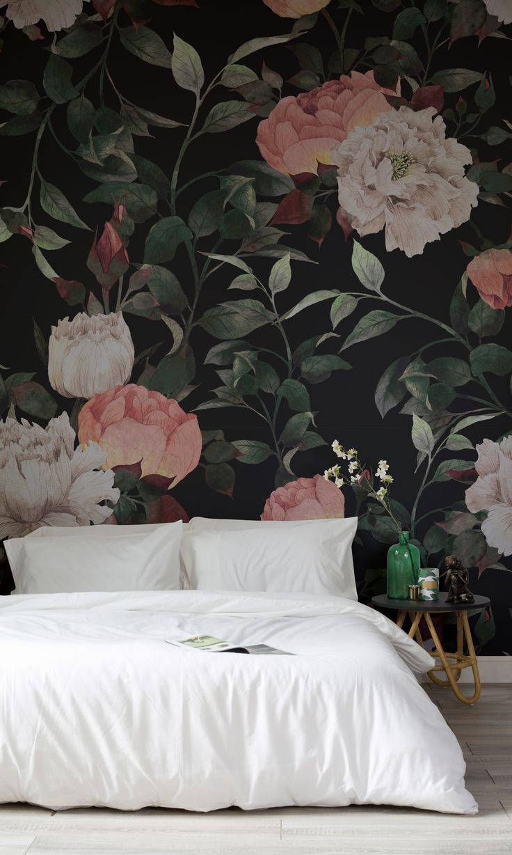 Make a statement with this dark floral wallpaper mural. Inky flowers are set against a sumptuously dark background, creating a dramatic effect in any interior. Perfect for bedroom spaces looking for a truly sophisticated feel.