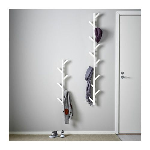 TJUSIG Hanger IKEA The hanger helps you transform an empty wall into a practical storage space for clothes, bags and shoes.