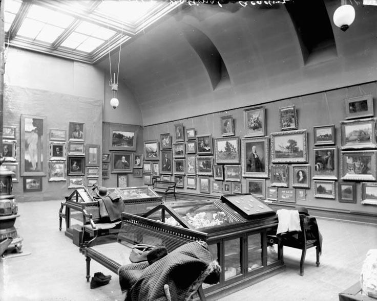 Exhibit Room of the National Gallery, upstairs in the Fisheries Building at Queen and O'Connor, in 1900. Natural light and a wood stove!