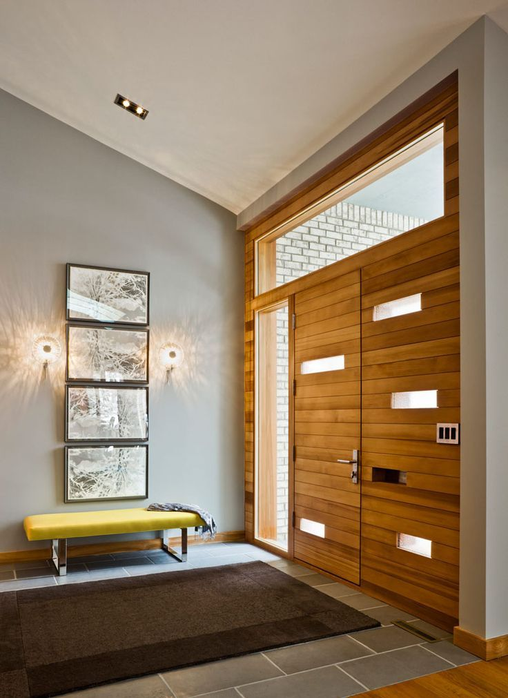 Entryway Design Ideas - 3 Different Styles Of Entryway Benches // This yellow bench adds a pop of color to the entryway and makes the perfect place to sit while you pull on your boots or sneakers.