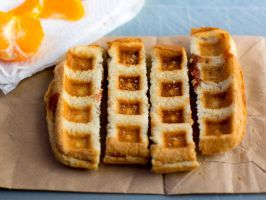 "Waffled Peanut Butter and Jelly : Waffle machines are fun to use, and nowadays you can  <a adhocenable=""false"" href=""http://www.foodnetwork.com/recipes/photos/waffle-it-hits-and-misses-behind-the-scenes.html"" target=""_blank"">waffle just about anything</a>. For this recipe, just make your usual PB&J and waffle it!"