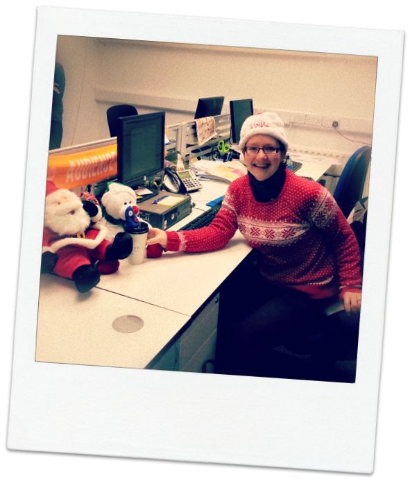 Sarah in our office getting ready for the #toyshow tonight - Christmas jumpers at the ready ..