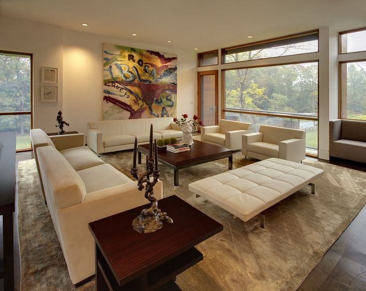 Gorgeous subdued palette in this mid-century modern living room.