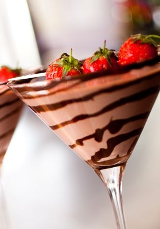 Chocolate Covered Strawberry Martini  - cocktail glass, chilled  - 1 1/2 oz Godiva Chocolate liqueur  - 1 1/2 oz White Creme de Cacao  - 1/2 oz Stoli Strasberi vodka  - 2 1/2 oz cream  - strawberry, garnish  - chocolate syrup, garnish