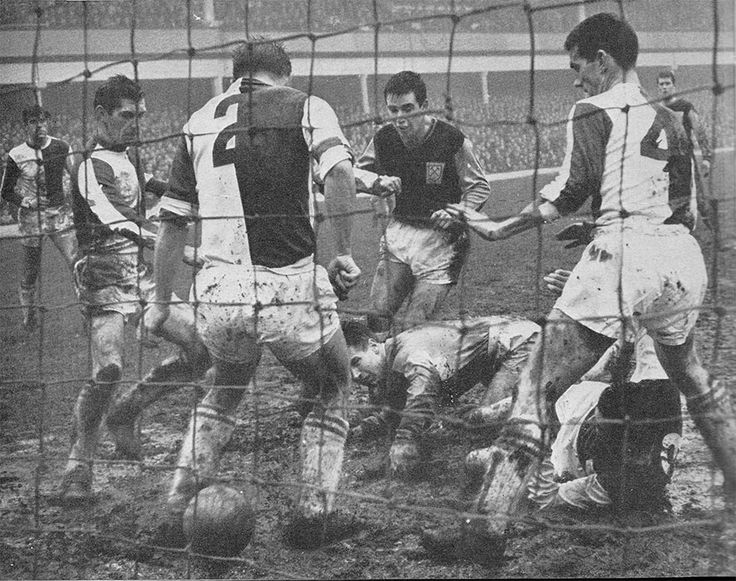 26th December 1963. West Ham United centre forward John 'Budgie' Byrne (on the floor) scrambles the ball through the legs of Blackburn Rovers full back Keith Newton to score on a day when the Hammers lost 8-2, at Upton Park.