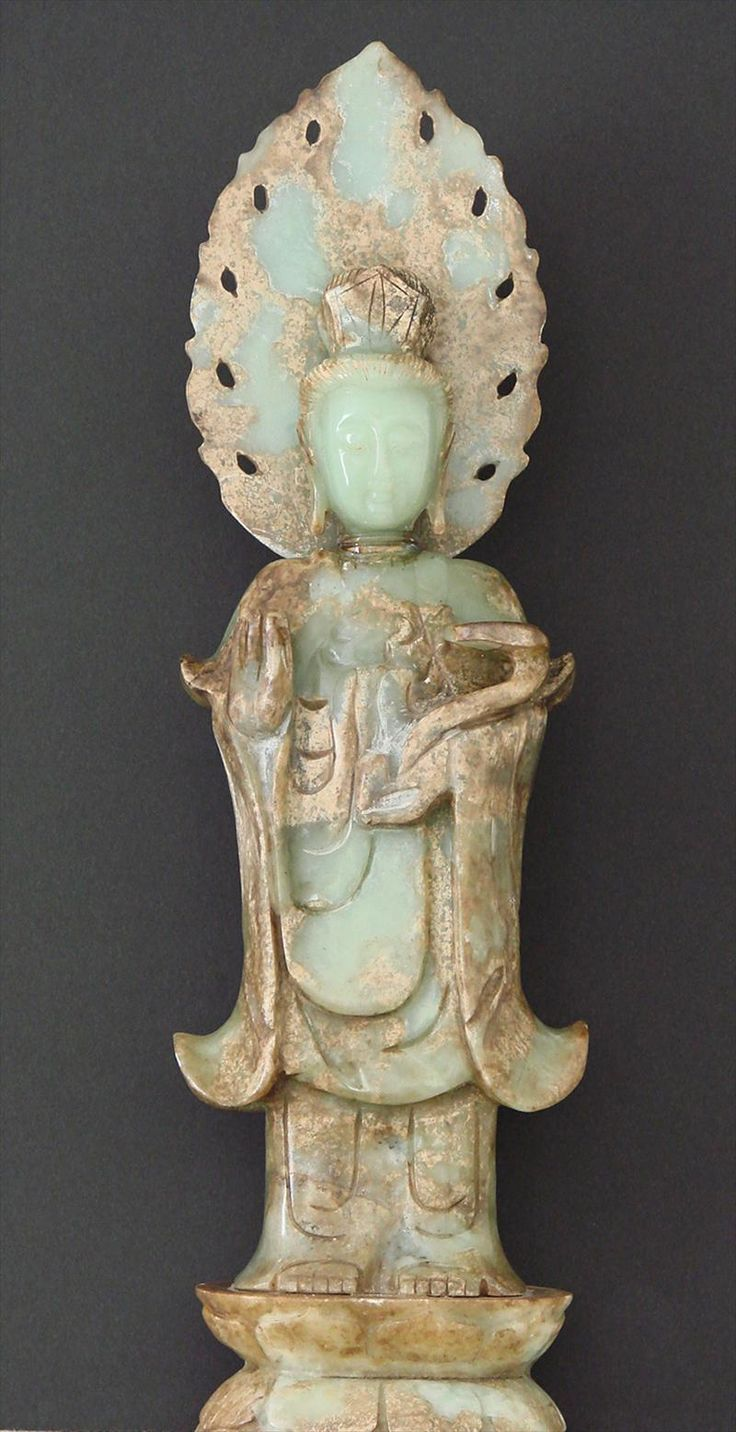 """Quan Yin"" Qing Dynasty Chinese Jade carving ""Quan Yin"" Chinese Jade carving, Qing Dynasty. A finely carved ""Quan Yin"" figure in mottled jade of earth tones and green hues, with the face in a more purer form of transluscent green, reflecting the serenity of the bodhisattva. Est. 7,000-10,000"