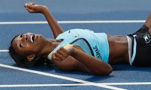 Shaunae Miller reacts when she sees the result.