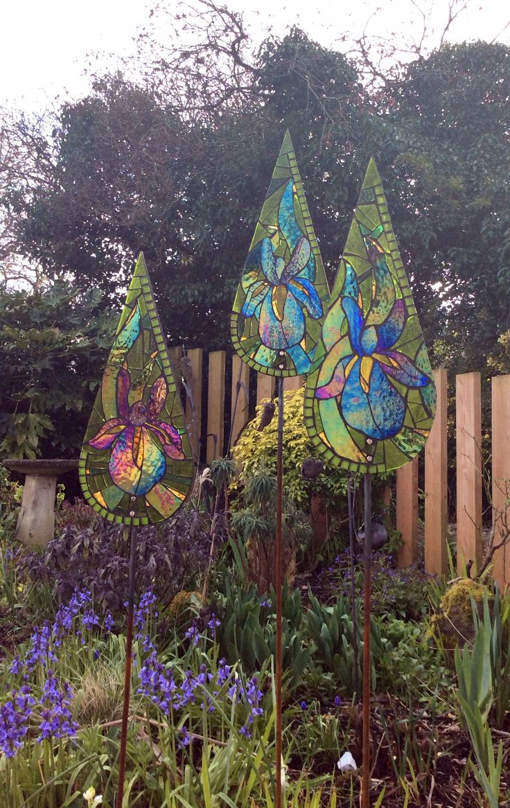 Irises glass mosaic garden sculpture. Art for the garden.  Handcrafted personalised gifts for gardeners.  www.primrosemosaics.comwww.primrosemosaics.com