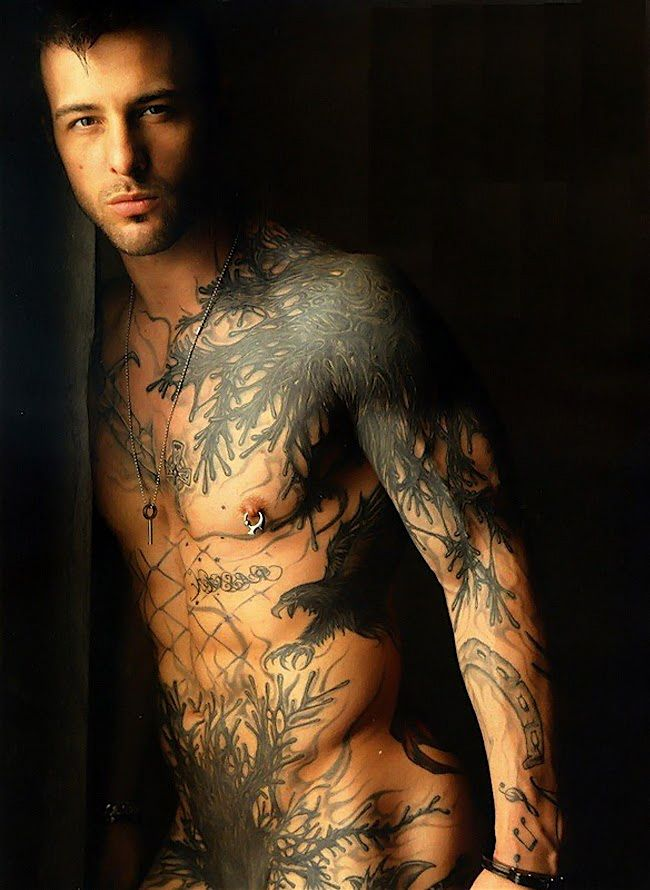 Naked tattooed hunk with a large penis