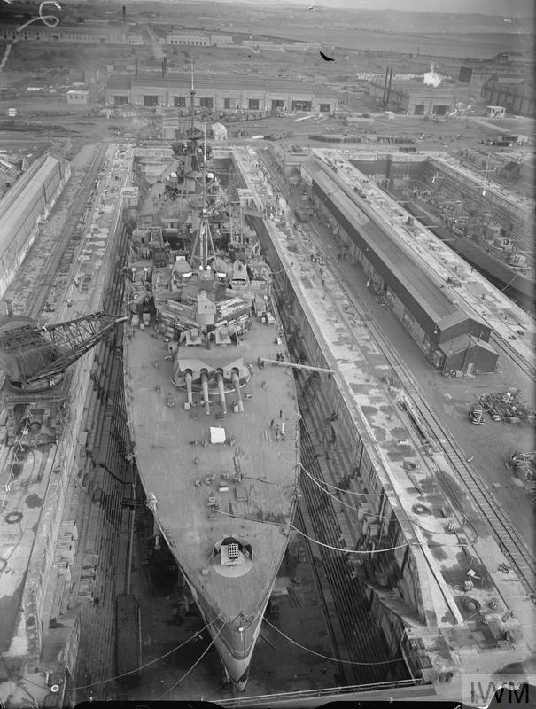 """HMS King George V. 1940, Rosyth, in dry dock."""" (IWM: A 1486)"""