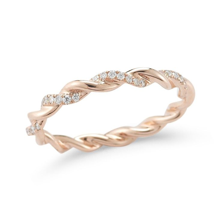 An undeniably timeless twist of delicate diamond details and a contemporary polished finish, this sleek rose gold eternity band is a must-have in any well curated jewelry collection. Flaunt it daily, solo or stacked, and let it speak for itself by creating a look that's uniquely yours.