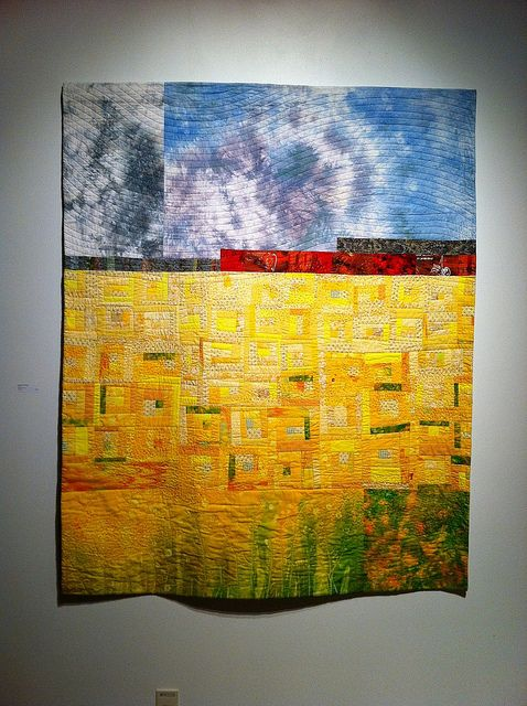 So where do I start?  The design, the fabrics, the color, the unexpected elements, the quilting? This is the kind of art quilt I WISH I could make.