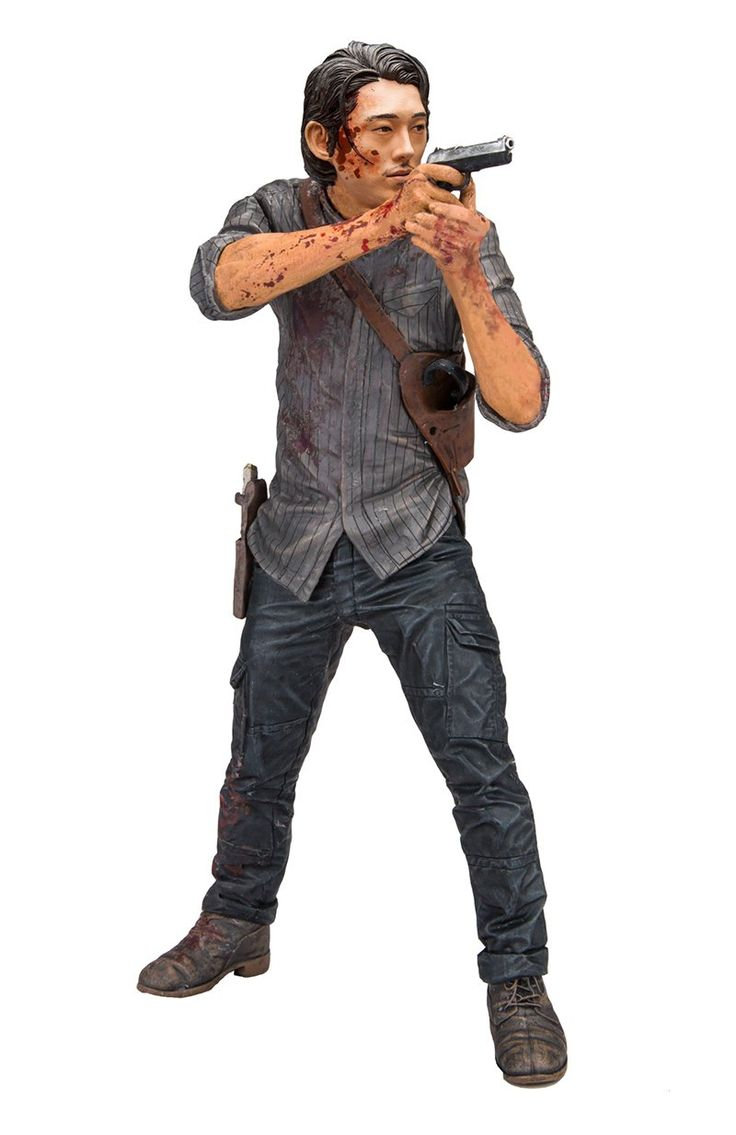 "McFarlane Toys The Walking Dead Glenn ""Legacy"" Edition Deluxe Figure. 10-inch scale figure packaged in a collector edition window box complete with stylized black circular base for dynamic posing. Features spectacular likeness of the actor Steven yeun, taken from a full 3D scan of the actor himself. Figure features blood splatter paint effect. Figure includes new arms holding Glenn's pistol accessory."