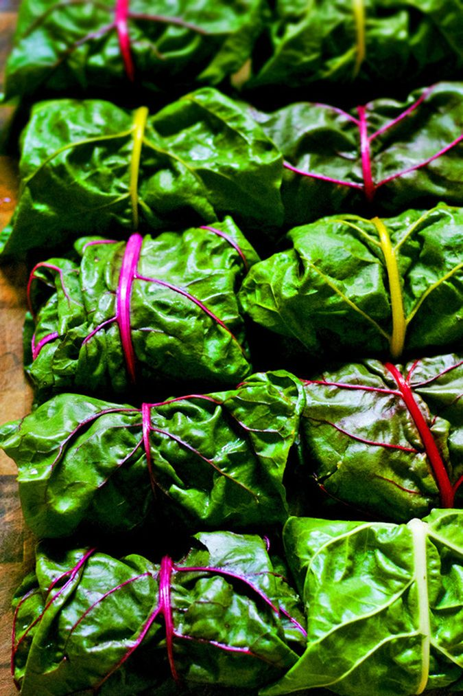 """Brown rice, currants, chickpeas, and herbs, all rolled up in a swiss chard leaf. A healthy """"raw"""" vegan wrap idea for entertaining."""