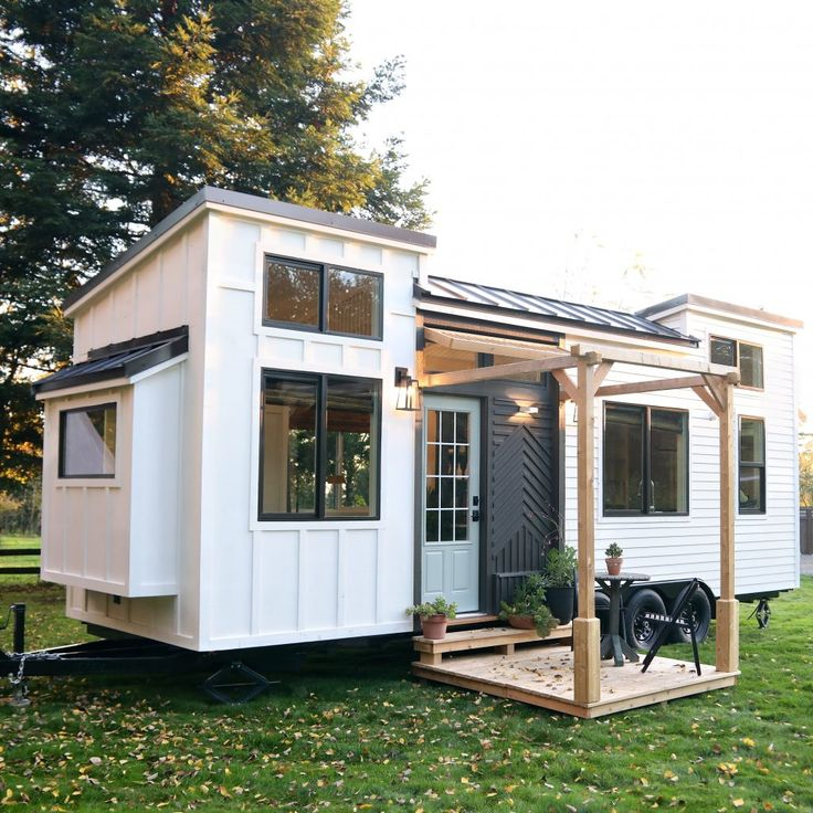 The latest Tiny Home from Handcrafted Movement, Pacific Harmony. Exterior features- 28' x 8.5' Industry leading Iron Eagle Tiny House Trailer with (3) 7K axles Built in leveling jacks, trailer brakes, road lighting, sealed aluminum floor pan Board and batten siding with Pacific Cedar accents Standing seam metal roof, 12-lite glass exterior door with handle…