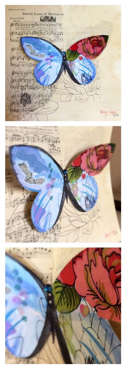 Watercolour butterfly on a ripped song sheet with a fabric rose, paper cuts, sequins and gems.