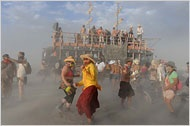 Burning Man, and unlike most music festivals of a similar magnitude, organizers do not pay big-name entertainers. Instead, they rely on attendees to build infrastructure and provide entertainment for themselves.    Organizers said they were looking at a multipronged solution that might include printing names on tickets to discourage scalping, requesting that the federal Bureau of Land Management increase the cap on participants allowed on the site and perhaps distributing some of the r