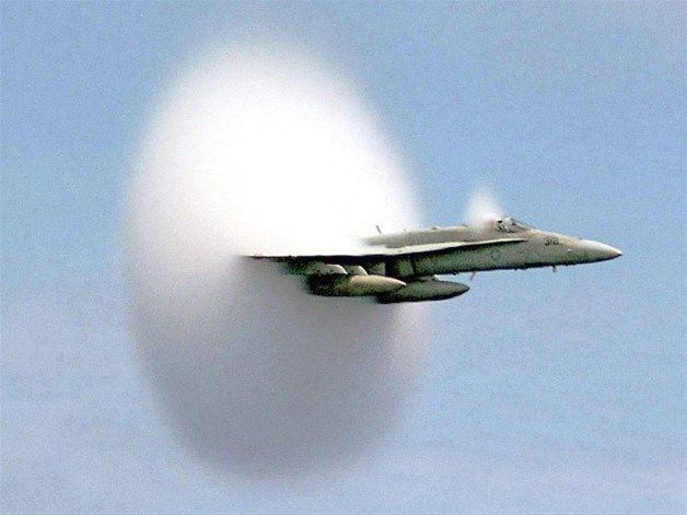 A cloud forms as an F/A-18 Hornet aircraft accelerates to supersonic speed. Aircraft flying this fast push air up to the very limits of its speed, forming what's called a bow shock in front of them. (© Ensign John Gay, USS Constellation, US Navy) Awesome!!!