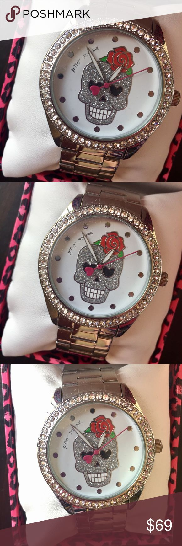 Betsey Johnson Silver Skull Sparkle Red Rose Watch NIB Betsey Johnson Silver Skull Sparkle Red Rose Watch  - comes in original leopard print Betsey box.  - Dial Color: Silver-tone with sparkling skull and red rose details - Hands: White luminous with fuchsia second hand - Markers: Silver-tone - Bracelet material: Stainless steel - Clasp Type: Deployment - Movement: Quartz Betsey Johnson Accessories Watches