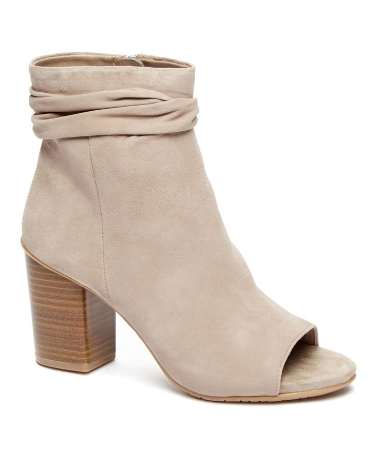 Show off your pedi and update your cool-weather looks with this trend-right  bootie that features a chic peep toe and chunky heel for a modest boost.