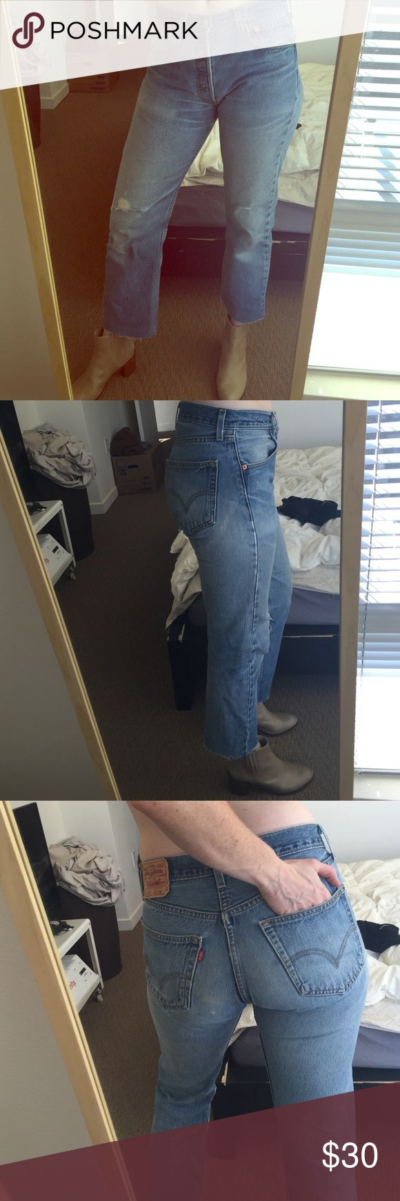 """Vintage Levi's cropped 501 Vintage high rise button fly cropped destroyed Levi's 501s. Laying flat waist is 15"""" across, inseam is 27"""" front rise 11"""". I am a 4/6, usual 27/28 in denim for reference, and These are a size big on me once worn for a few hours. Good amount of authentic spots, rips etc. raw hem. 100% cotton. Bought from high end vintage shop in Portland OR. Levi's Jeans Ankle & Cropped"""