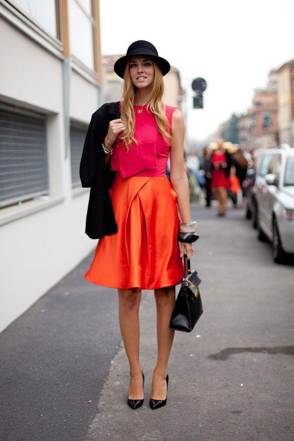 STREET STYLE SPRING 2013: MILAN FW - Black extras ground a bright dress.
