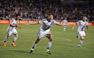 Los Angeles Galaxy's Steven Gerrard, center, of England, celebrates his first goal for the team, during the first half of an MLS soccer match against the San Jose Earthquakes, Friday, July 17, 2015, in Carson, Calif