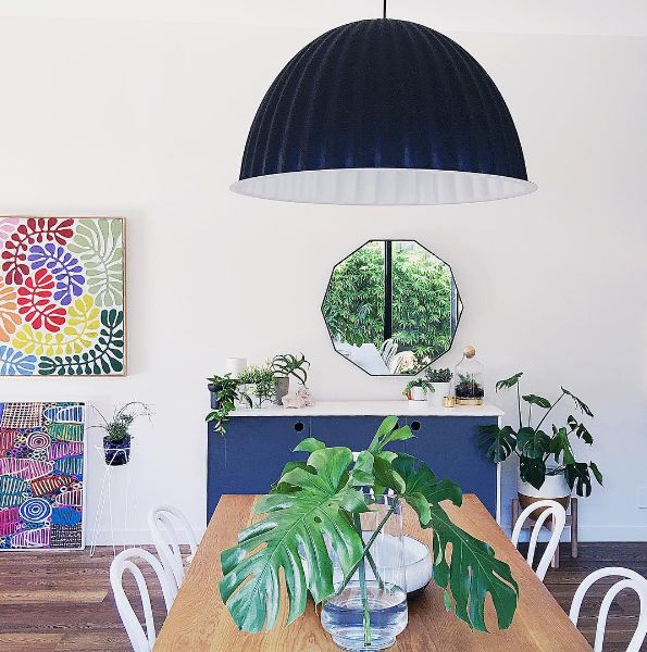 "http://www.surrounding.com.au/under-the-bell-pendant-black/ regram: @michelle_baskinteriors I'm kind of rolling with a dining room theme so thought I'd share mine from a different angle. . I love the @muutodesign Under The Bell pendant from @surroundingaustralia, it's a real statement piece which defines this as the dining room space of an open plan area. The kids refer to it as ""the giant jelly cup"" . It was designed by Iskos-Berlin, made of recycled plastic felt, it absorbs sound and helps"