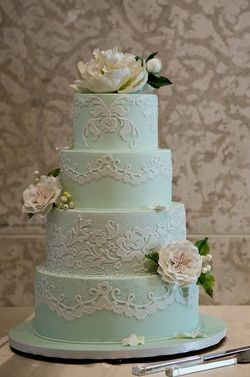 love the piping. i would switch it to blue piping and a white cake. flowers are beautiful too